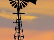 Madison County sunset behind a classic windmill. :)