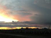 Thunderstorm lightening and sunset over Live Oak and The Sutter Buttes