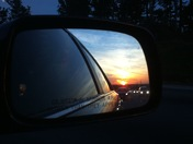 Sunset in the side view Mirror