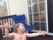 Bella enjoying Easter chasing bubbles.