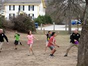 Youth enjoying frisbee with Pittsfield Police Officers