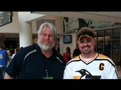 Jim and madden at a penguin game