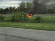 Car burning behind Calvary church this morning