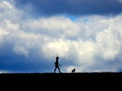 Walking her dog in the clouds