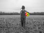 Girl walking in a farm field