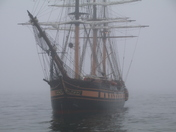 Tall ships in the fog