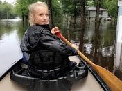 Faith de la Houssaye canoeing down Johnson Street in Madisonville, Louisiana.