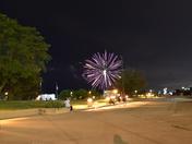 Milwaukee skyline and surrounding landmarks by night.
