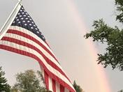 Flag and rainbow