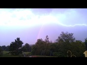 Lightening flash through rainbow in Hooksett