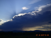nice clouds with rain looking over streaked mountain looking from minot