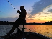 Watching sunset on Lake Keowee while Randy fishes