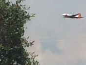 Air tanker flying over D'Agostini on it's way to fire on Omo Ranch Rd.
