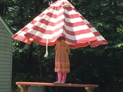 Emmalyn helping with deck umbrella in New London