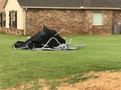 Backyard destroyed trampoline mangled and landed down the street