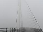 Running through Thick Fog on the Pedestrian Bridge