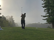 Teeing off into the fog