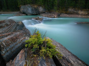 Water stream flow over the Natural Bridge over the Kicking Horse River