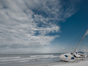 Boat washed on Melbourne Beach shores @ Speared Holland South Beach Park