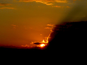 Clouds invade the setting sun in Moultonborough