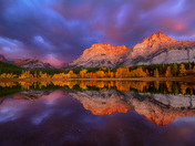 Fall foliage sunrise at Wedge Pond in Kananaskis