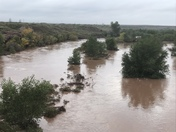 Pecos river flowing bank to bank