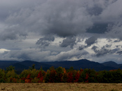 Foliage and stormy skies across the Sandwich Range in Sandwich, NH