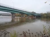 Dislodged motorboat stuck under the Amoskeag Bridge on Orange floatation devices