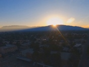 AREIAL VIEW OF THE SUN RISING OVER THE SANDIA'S ( 250 FEET ALTITUDE )