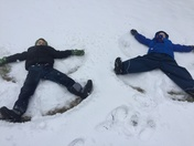 Boys loving the snow.