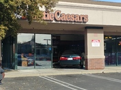Car crashes into Little Caesars