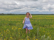 Girl running in Canola Field