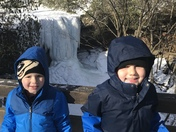 Keith (5) and Logan (3) Hiles of Dawson, brave the cold to see the frozen Cucumber Falls.