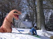 Quinn Marcotte of Sewickley gets his dino suit on for a little sledding with His brother Emmett.