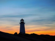 A silhouette of Peggy's Cove