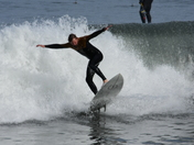 Talking about the High Surf warning. Couple pictures of people surfing along the Old Monterey Wharf!
