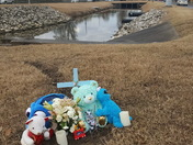 Memorial from site where baby was killed during ice.