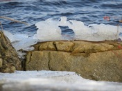 Ice formation on top of rocks