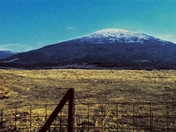 Sugar Loaf Mnt with snow/ice on top of it.
