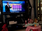 My granddaughter Autumn watching Bill Randby talk about all this cold weather we're having!!