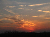 Sunset west of Cashion by Teresa Karnes (who loves Oklahoma sunsets)