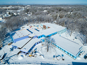 The New Hall School being built under snow.