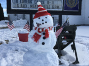 Another tough day at work. Patriotic snowman.