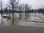 The Salmon River in Fort Covington, NY rising over the road.