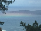 Rainbow laying on top of the ocean this morning