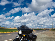 Puffy clouds, blue skies, noontime today, SE of Walnut Grove on Staten Island in San Joaquin County. Motorcycle in foreground