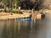 Trampoline blown by the wind into Ski Island Lake