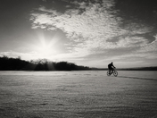 Cyclist on a frozen lake