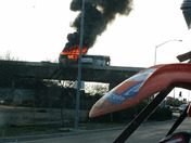Bus on fire on highway 99 and Arch road overpass. Happens right about 5 pm today