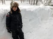 Hunter building snow fort